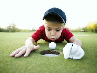 Sidebar sidebar golf ball in hole high res2  1